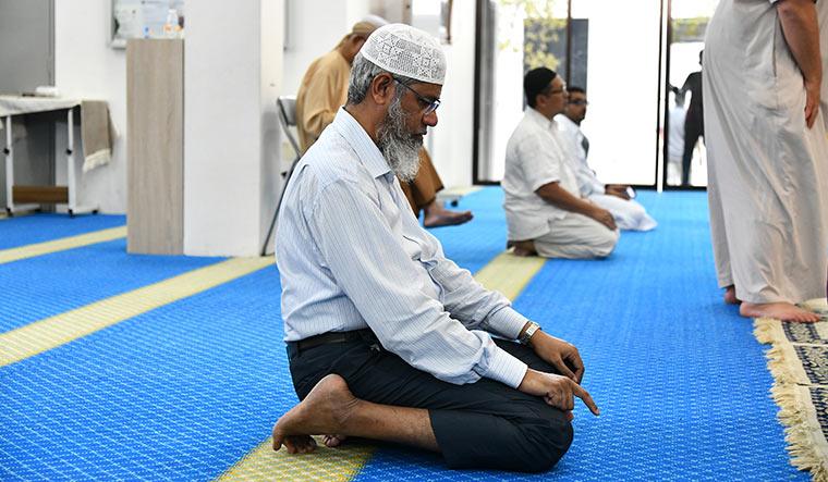 Unwavering faith: Naik praying at a mosque in Putrajaya | Sanjay Ahlawat
