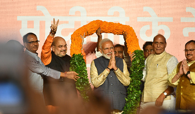 Tryst with trust: (From left) Shivraj Singh Chouhan, Amit Shah, Modi and Rajnath Singh celebrate the victory at the BJP headquarters in Delhi | Sanjay Ahlawat