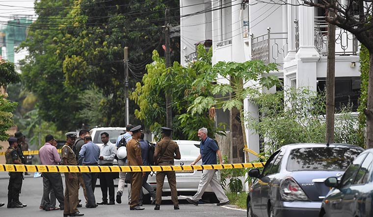 Looking for leads: Officers from international investigative agencies at the home of one of the suicide bombers in  Dematagoda, Colombo | Bhanu Prakash Chandra