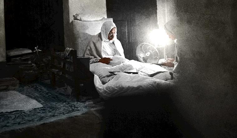 AVID reader: Gandhi reading a letter in Calcutta, in 1946 | Dinodia