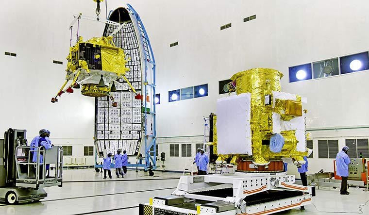 Locked and loaded: Chandrayaan-2's lander, Vikram, is hoisted before being mounted on the orbiter (right), at the launch centre in Sriharikota | Courtesy ISRO