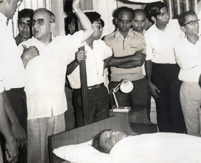 End of an era: Vikram Sarabhai's body at the Halcyon Castle, Kovalam. TERLS director H.G.S. Murthy is seen gesturing to others.