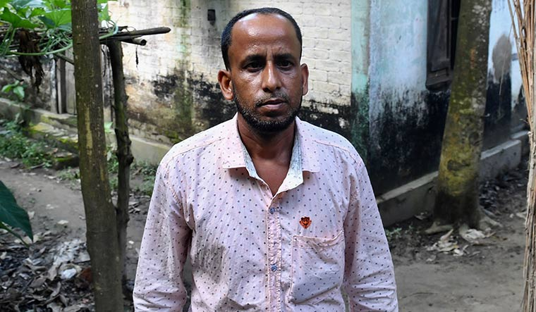 Samsul's two sons, Rafikul and Moijul, have been tagged as Bangladeshis. The Nagaon bench of the foreigners' tribunal has already declared Rafikul (in pic) an illegal immigrant.