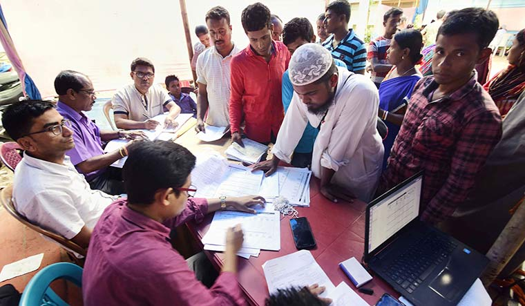 The gatekeepers: NRC officials in Nagaon checking the documents of people whose names did not figure in the draft list | PTI