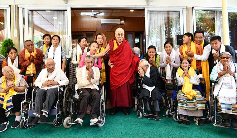 Holy encounter: The Dalai Lama meets visitors at his residence in Mcleodganj.