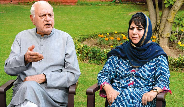 Home, but not quite: Farooq Abdullah and Mehbooba Mufti | AFP
