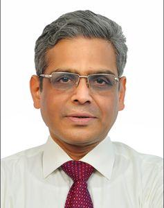 Dr Krishna Kumar