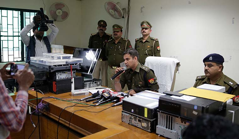 Setting an example: Ajay Pal Sharma, IPS, addressing a media conference in Noida. It was Sharma's team that pioneered the encounter spree in the state | AP