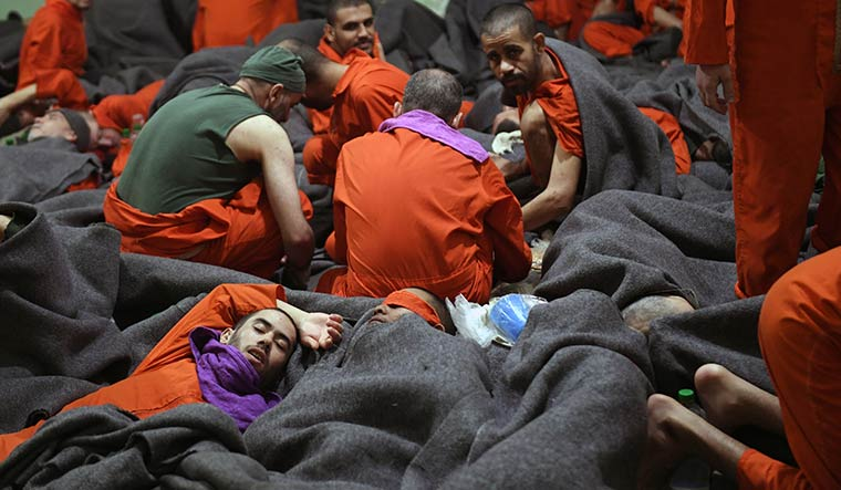 Picture of misery: Prisoners awaiting trial at the Al-Hasakah prison.