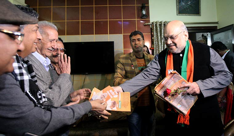 Homing in: Amit Shah during his door-to-door CAA campaign in Delhi | Getty Images
