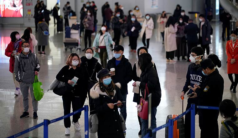 On tenterhooks: Passengers at the Pudong International Airport in Shanghai | reuters