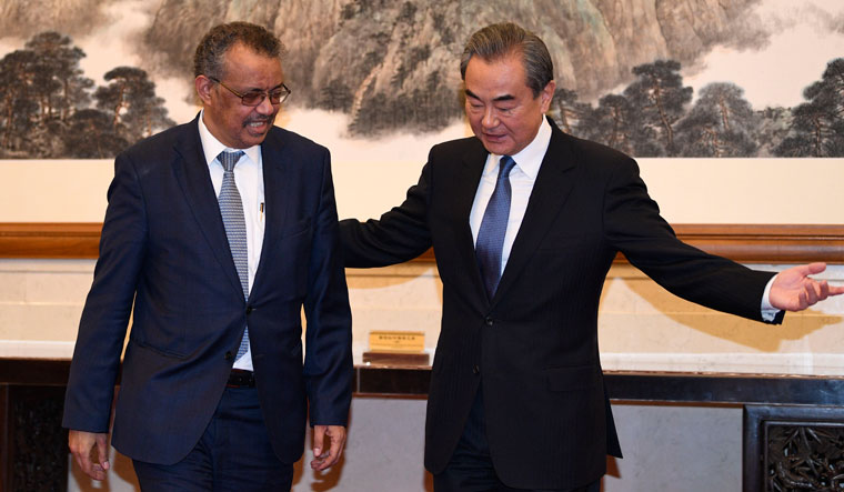 Needle of suspicion: Tedros Adhanom, director general of WHO, met with China's Foreign Minister Wang Yi in Beijing in January. Yan says that the Chinese government and the WHO swept everything under the carpet | Getty Images