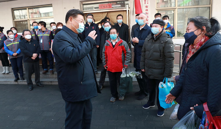 Masked communication: Chinese President Xi Jinping inspecting the Covid  19 prevention and control work at Anhuali Community in Beijing in February. Yan says that Xi declared that Covid  19 was a very serious infectious disease only after her views—that the virus was man-made—were aired anonymously on a YouTube channel | REUTERS