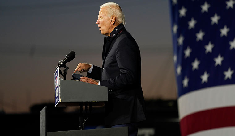 Riding a wave: Joe Biden speaks at Michigan State Fairgrounds in Novi | AP