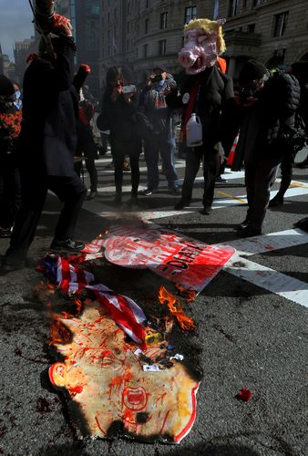 Counter-demonstrators burn Trump in effigy during a rally in Boston | Reuters