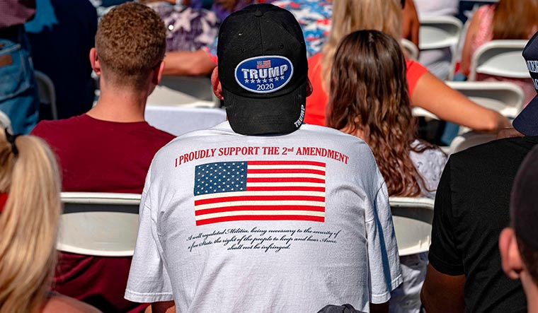 All the President's men: A Trump supporter at a rally at Prescott Regional Airport in Arizona | AFP