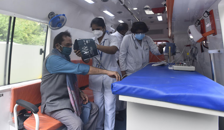 Check's up: Medical staff from Holy Family Hospital check Union Minister for Minority Affairs Mukhtar Abbas Naqvi inside a mobile clinic in New Delhi | Getty Images