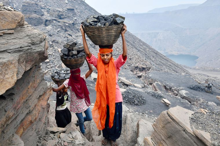 Living dangerously: (Left) Suman Kumari (with orange scarf) collects coal in the morning and goes to college during the day.