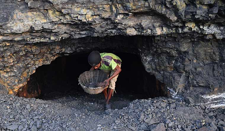 By hook or crook: A hole like this dug by villagers to extract more coal has turned into a death trap for many.