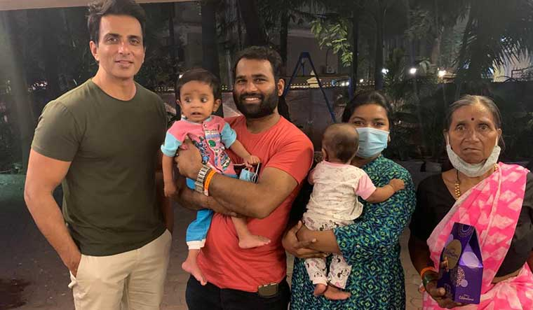 Sweet meet: Snehal misal (second from right), and her family with sood. The actor arranged for her son's heart surgery.