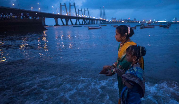 Beliefs and the sea: Koli community members perform Narali Purnima rituals in Mumbai. Commodore Johnson says that such cultural practices indicate awareness of weather- and monsoon-guided commencement of sea voyages | Getty Images