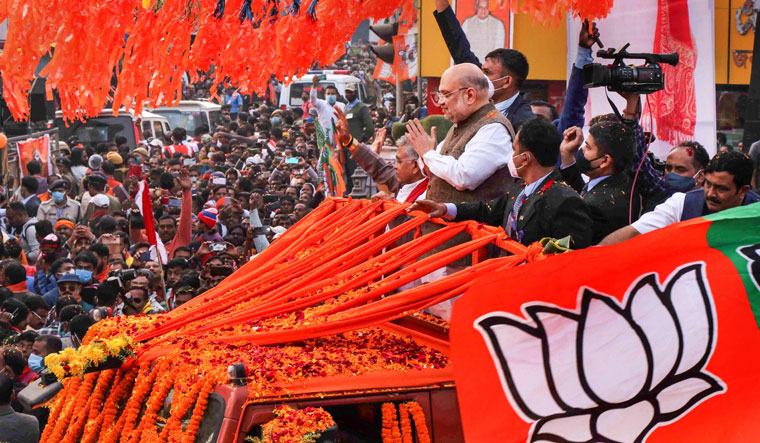 War cry: Union Home Minister Amit Shah during a roadshow at Bolpur in Birbhum | PTI