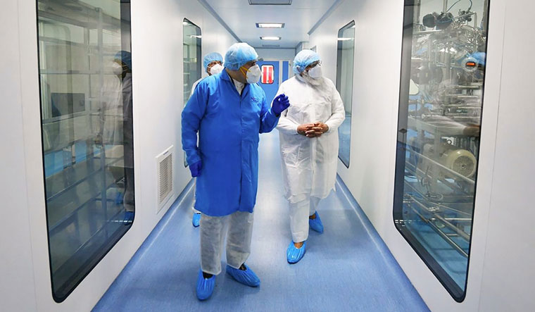 Personal supervision: Prime Minister Narendra Modi (right) being briefed on the progress of Covaxin, at the Bharat Biotech facility in Hyderabad | PTI