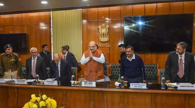 Taking stock: Union Home Minister Amit Shah and Delhi Chief Minister Arvind Kejriwal at a high-level meeting in Delhi on February 25 | PTI