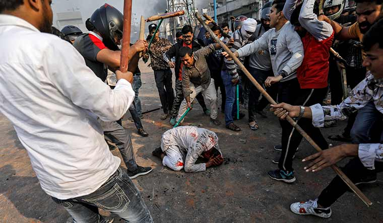 Gruesome sight: Mohammad Zubair being beaten by armed men during clashes in Delhi | Reuters