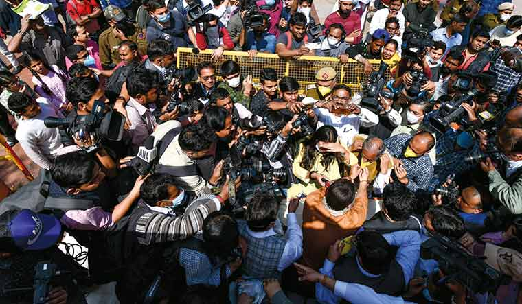Social distancing, anyone?: Mediapersons surround Delhi BJP president Manoj Tiwari as he distributes masks and hand sanitisers at Connaught Place in Delhi | Sanjay Ahlawat