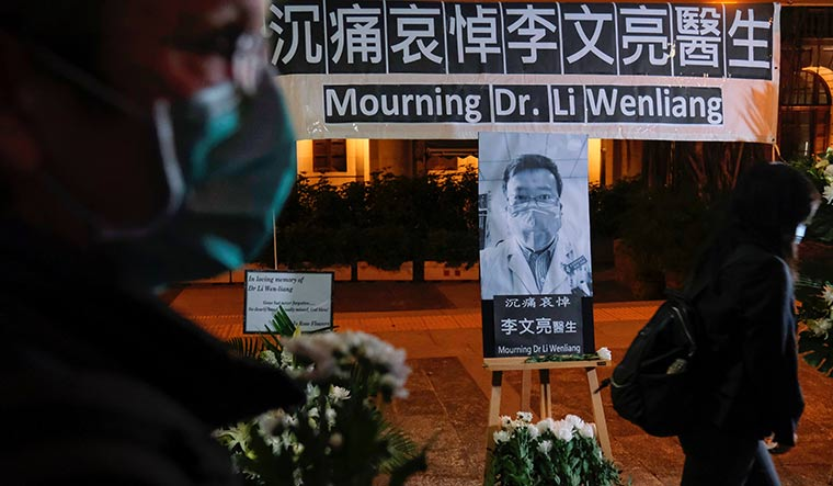 Immortal courage: People arrive to attend a memorial in honour of Li Wenliang, the ophthalmologist who first sent out warnings about Covid-19 and later succumbed to the virus | Reuters