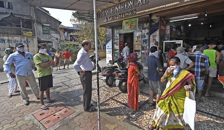 Keeping their distance; People in a queue outside a store in Vasai, Mumbai | Amey Mansabdar