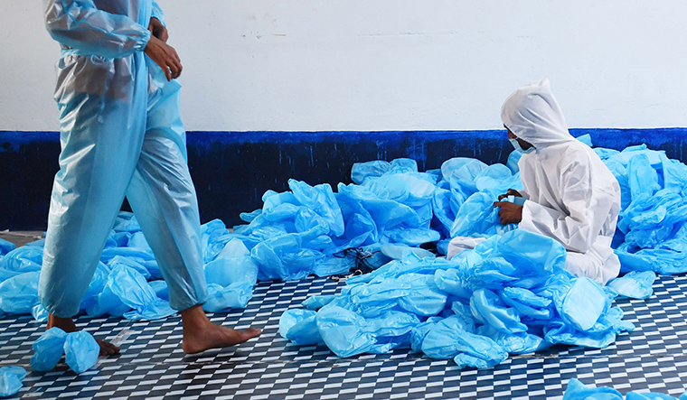 Gear-ed up: Workers in Kolkata make PPE for the health department | Salil Bera
