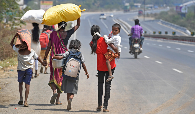 Long road ahead: Migrant labourers on the Mumbai-Ahmedabad highway, en route to their homes in Dahanu, in Palghar district of Maharashtra | Amey Mansabdar
