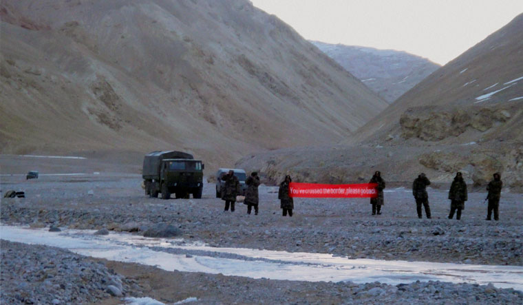 Written command: A 2013 file photo of Chinese troops with a banner asking Indian soldiers to 'go back' in the Daulat Beg Oldie sector of Ladakh | PTI