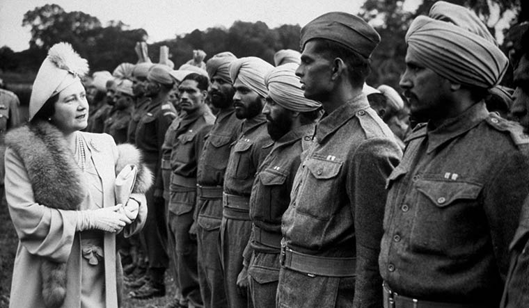 The raj at war: Queen Elizabeth, wife of King George VI, visiting Indian soldiers in London in 1945, after they were released from German prisoner-of-war camps | Getty Images