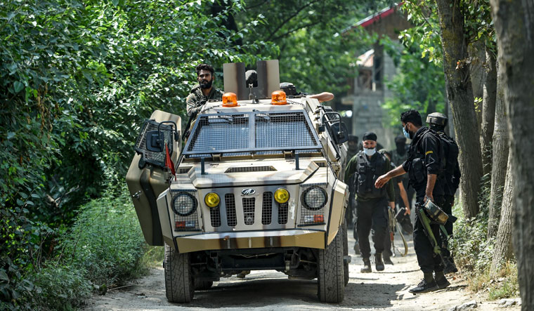 On the prowl: Special Operations Group personnel leave a gun-battle site on the ouskirts of Srinagar, where two militants were killed on July 25 | AFP