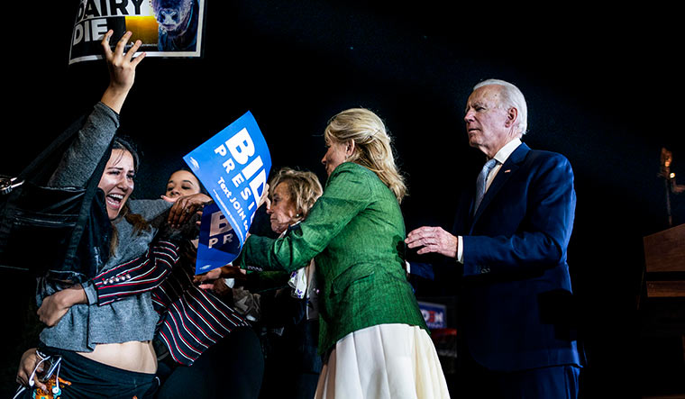 Jill Biden wards off protesters who stormed the stage during a rally in March | Getty Images