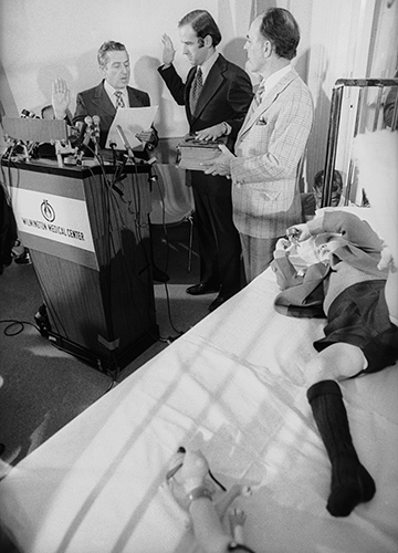 Through thick and thin: Biden takes oath as senator at the bedside of his son, Beau, in a hospital in 1972 | Getty Images