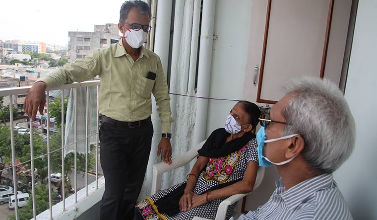 Bad phase: Ronak Kotadia (standing) had to cancel his father's cataract operation because of his job loss | Janak Patel