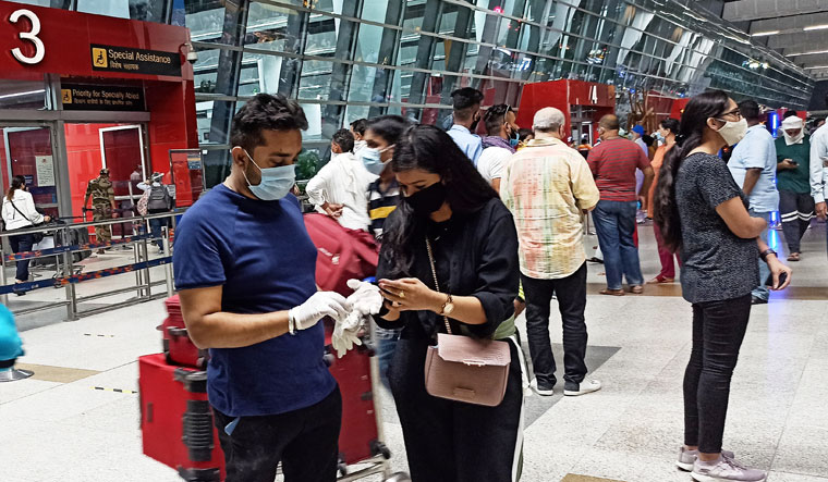 Passengers wearing protective gear before entering the Delhi airport | Aayush Goel