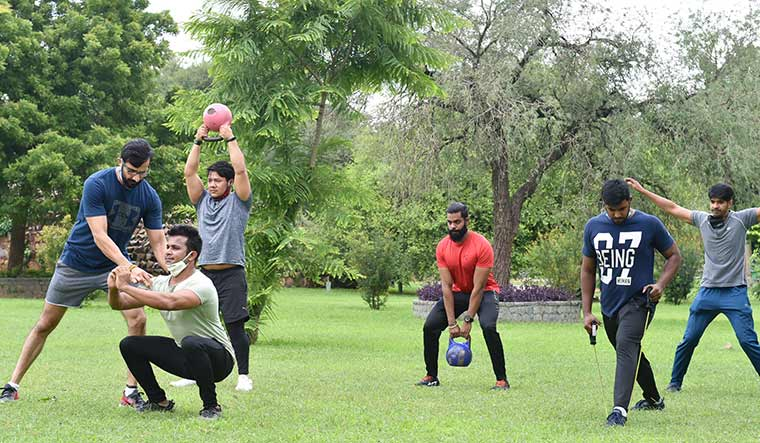 Parks and recreation: With gyms in Delhi closed, people have been attending fitness sessions in public parks | Aayush Goel