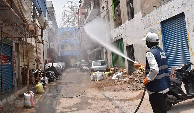 53-A-health-worker-sprays-disinfectant
