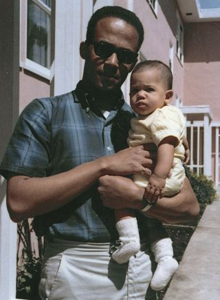 In happier times: Baby Kamala with her father, Donald Harris. She has a complicated relationship with her father and does not speak much about him | AP