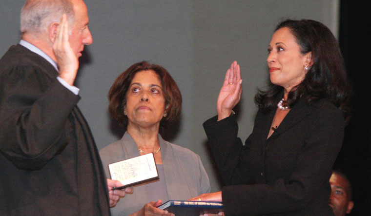 Mom's the word: Kamala takes oath as San Francisco district attorney in the presence of her mother, Shyamala Gopalan, who is holding a copy of The Bill of Rights | AP