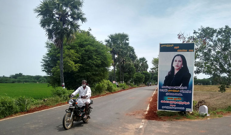 An inspiring tale: A banner featuring Kamala in Thulasendrapuram in Tamil Nadu, the ancestral village of her mother, Shyamala  | Reuters