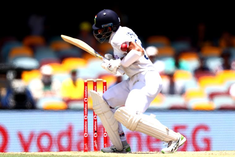 Man of steel: Pujara being struck by a short ball from Pat Cummins on day five at the Gabba   AFP
