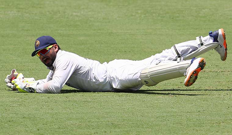 Eyes on target: Pant reacts after taking a catch to dismiss Matthew Wade on day four of the Gabba Test | AP