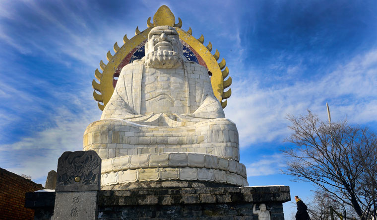 A 12m-high marble statue of Bodhidharma on the summit of the Wuru Peak, two kilometres northwest to the Shaolin temple