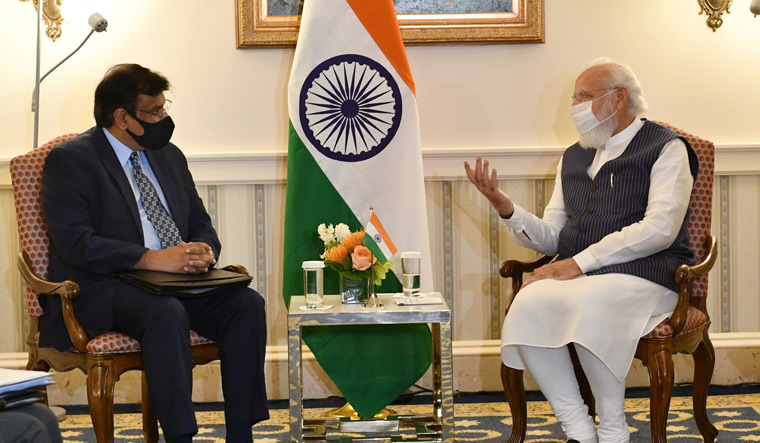 Friends in need: Prime Minister Narendra Modi with Vivek Lall, chief executive of General Atomics Global Corporation, in Washington, DC   PIB